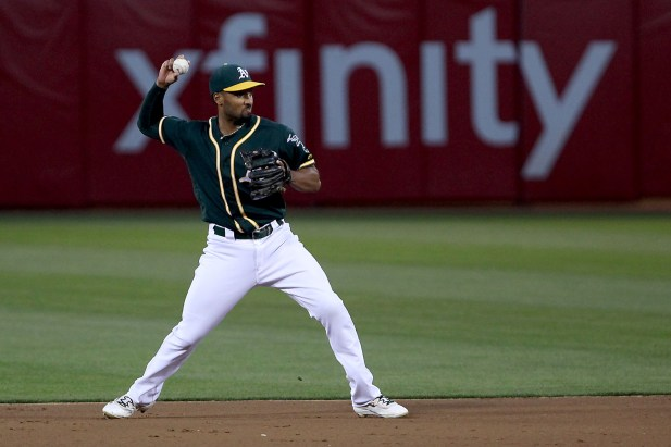 Oakland Athletics shortstop Marcus Semien (10) throws out Cleveland Indians second baseman Erik Gonzalez (9) on a groundout in the fifth inning as the Cleveland Indians face the Oakland Athletics at Oakland Coliseum in Oakland, Calif., on Friday, July 14, 2017.