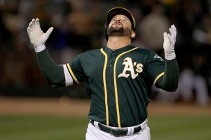 Oakland Athletics first baseman Yonder Alonso (17) celebrates after a home run as the Cleveland Indians face the Oakland Athletics at Oakland Coliseum in Oakland, Calif., on Friday, July 14, 2017.