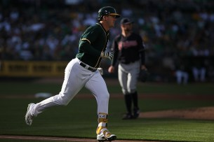 Oakland Athletics designated hitter Ryon Healy (25) flies out in the second inning as the Cleveland Indians face the Oakland Athletics at Oakland Coliseum in Oakland, Calif., on Saturday, July 15, 2017.