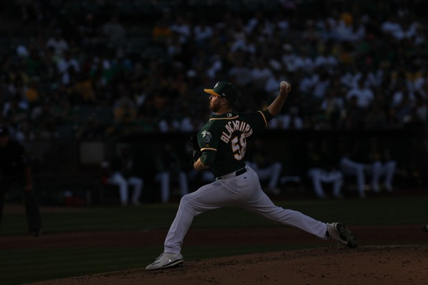 Oakland Athletics starting pitcher Paul Blackburn (58) throws a pitch in the third inning as the Cleveland Indians face the Oakland Athletics at Oakland Coliseum in Oakland, Calif., on Saturday, July 15, 2017.