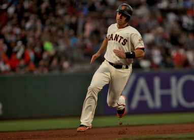 San Francisco Giants catcher Buster Posey (28) scores on a Crawford double in th fourth inning as the Cleveland Indians face the San Francisco Giants at AT&T Park in San Francisco, Calif., on Monday, July 17, 2017.