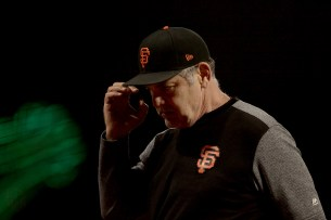 San Francisco Giants manager Bruce Bochy (15) walks back to the dugout after a pitching change in the ninth inning as the Cleveland Indians face the San Francisco Giants at AT&T Park in San Francisco, Calif., on Monday, July 17, 2017.