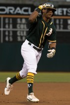 Oakland Athletics left fielder Khris Davis (2) salutes as he rounds the bases after hitting a home run in the fourth inning of the game against the Tampa Bay Rays at the Oakland Coliseum in Oakland, Calif., on July 17, 2017.