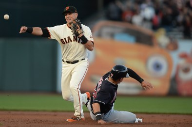 San Francisco Giants second baseman Joe Panik (12) completes the throw to first place for a double play to end the second inning as the Cleveland Indians face the San Francisco Giants at AT&T Park in San Francisco, Calif., on Tuesday, July 18, 2017.
