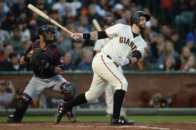 San Francisco Giants first baseman Brandon Belt (9) swings and misses for a strikeout / throwout to end the third inning as the Cleveland Indians face the San Francisco Giants at AT&T Park in San Francisco, Calif., on Tuesday, July 18, 2017.