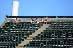 Fans watch from the upper deck as the Tampa Bay Rays face the Oakland Athletics at Oakland Coliseum in Oakland, Calif., on Wednesday, July 19, 2017.