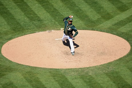 Oakland Athletics relief pitcher Santiago Casilla (46) throws the last pitch in the ninth inning as the Tampa Bay Rays fall to the Oakland Athletics 7-2 at Oakland Coliseum in Oakland, Calif., on Wednesday, July 19, 2017.