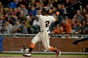 San Francisco Giants center fielder Denard Span (2) connects for an RBI single in the sixth inning as the San Diego Padres face the San Francisco Giants at AT&T Park in San Francisco, Calif., on Thursday, July 20, 2017.