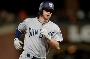 San Diego Padres third baseman Cory Spangenberg (15) rounds the bases after a two-run home run in the seventh inning as the San Diego Padres face the San Francisco Giants at AT&T Park in San Francisco, Calif., on Thursday, July 20, 2017.
