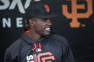 San Francisco Giants centerfielder Orlando Calixte (46) smiles in the dugout as the Pittsburgh Pirates face the San Francisco Giants at AT&T Park in San Francisco, Calif., on Monday, July 24, 2017.