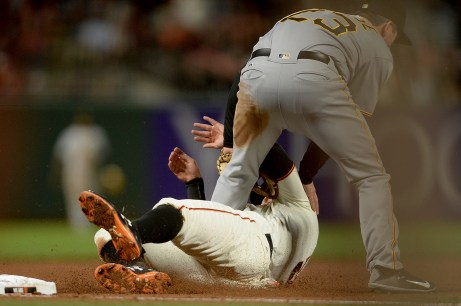San Francisco Giants first baseman Brandon Belt (9) is thrown out at third base in the fifth inning as the Pittsburgh Pirates face the San Francisco Giants at AT&T Park in San Francisco, Calif., on Monday, July 24, 2017.