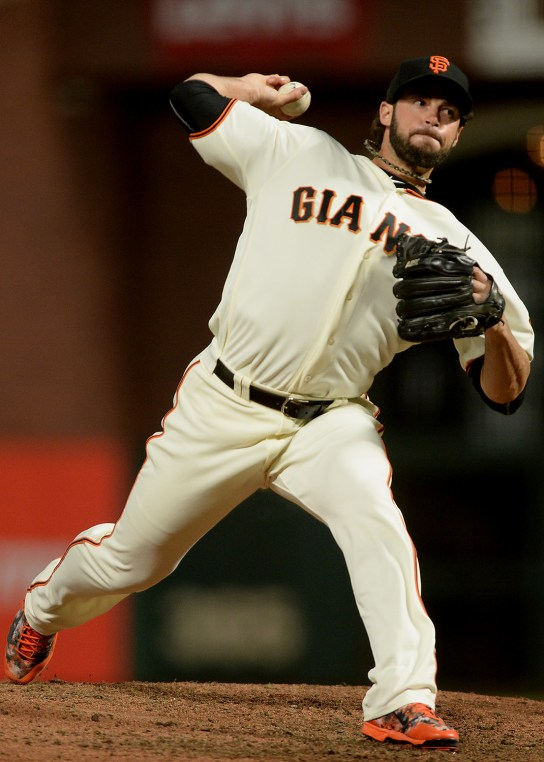 San Francisco Giants relief pitcher George Kontos (70) throws a pitch in the seventh inning as the Pittsburgh Pirates face the San Francisco Giants at AT&T Park in San Francisco, Calif., on Monday, July 24, 2017.
