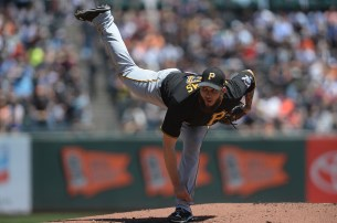 Pittsburgh Pirates starting pitcher Trevor Williams (57) throws a pitch in the first inning as the Pittsburgh Pirates face the San Francisco Giants at AT&T Park in San Francisco, Calif., on Wednesday, July 26, 2017.