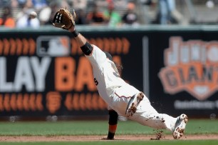 San Francisco Giants shortstop Brandon Crawford (35) can't secure an infield single hit by Pittsburgh Pirates catcher Francisco Cervelli (29) as the Pittsburgh Pirates face the San Francisco Giants at AT&T Park in San Francisco, Calif., on Wednesday, July 26, 2017.