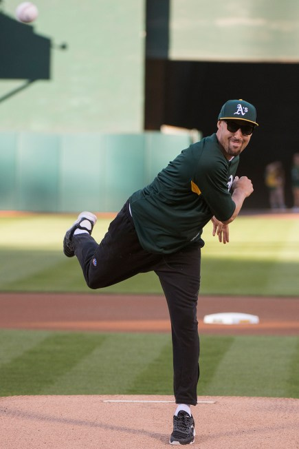 Golden State Warriors guard Klay Thompson (11) throws out the ceremonial first pitch prior to the game between the San Francisco Giants and the Oakland Athletics at the Oakland Coliseum in Oakland, Calif., on July 31, 2017.