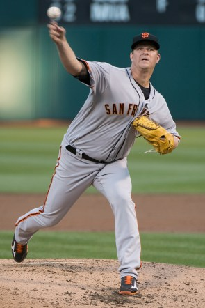 San Francisco Giants pitcher Matt Cain (18) pitches in the second inning of the game against the Oakland Athletics at the Oakland Coliseum in Oakland, Calif., on July 31, 2017.