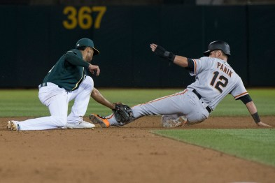 Oakland Athletics shortstop Marcus Semien (10) tags San Francisco Giants second baseman Joe Panik (12) out at second on a steal attempt in the fifth inning of the game against the San Francisco Giants at the Oakland Coliseum in Oakland, Calif., on July 31, 2017.