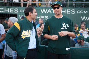 Oakland Athletics president David Kava talks with Golden State Warriors guard Klay Thompson (11) prior to the game between the Athletics and the San Francisco Giants at the Oakland Coliseum in Oakland, Calif., on July 31, 2017.