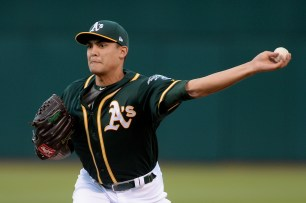 Oakland Athletics starting pitcher Sean Manaea (55) throws a pitch in the first inning as the San Francisco Giants face the Oakland Athletics at Oakland Coliseum in Oakland, Calif., on Tuesday, August 1, 2017.