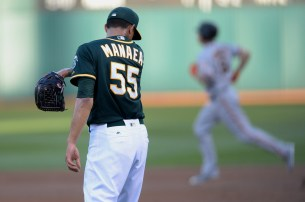 San Francisco Giants catcher Nick Hundley (5) rounds the bases as Oakland Athletics starting pitcher Sean Manaea (55) wipes his brow after a home run in the first inning as the San Francisco Giants face the Oakland Athletics at Oakland Coliseum in Oakland, Calif., on Tuesday, August 1, 2017.