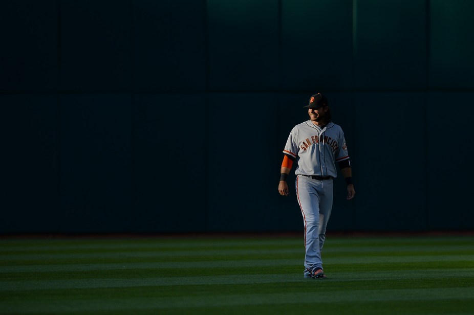 San Francisco Giants shortstop Brandon Crawford (35) stretches on the field before the San Francisco Giants face the Oakland Athletics at Oakland Coliseum in Oakland, Calif., on Tuesday, August 1, 2017.