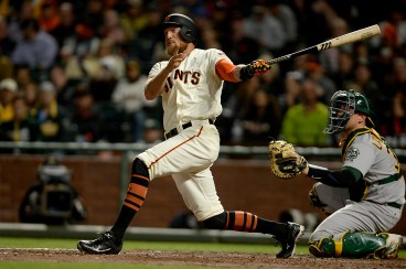 San Francisco Giants right fielder Hunter Pence (8) doubles in the fifth inning as the Oakland Athletics face the San Francisco Giants at AT&T Park in San Francisco, Calif., on Tuesday, August 2, 2017.