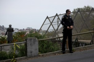 Police block streets surrounding the park as they search for multiple suspects in a shooting at Dolores Park in San Francisco, Calif., on Thursday, August 3, 2017.