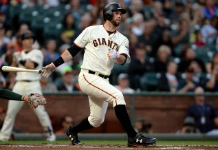 San Francisco Giants first baseman Brandon Belt (9) doubles in the first inning as the Oakland Athletics face the San Francisco Giants at AT&T Park in San Francisco, Calif., on Thursday, August 3, 2017.