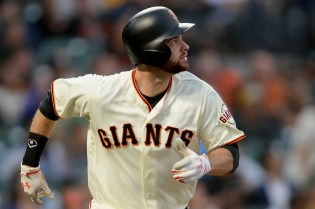 San Francisco Giants first baseman Brandon Belt (9) watches a home run in the second inning as the Oakland Athletics face the San Francisco Giants at AT&T Park in San Francisco, Calif., on Thursday, August 3, 2017.