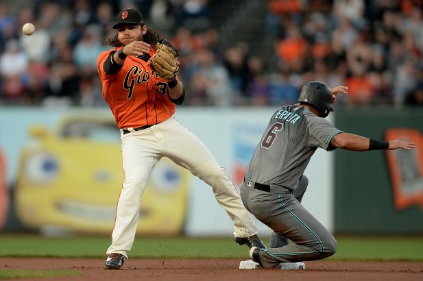 San Francisco Giants shortstop Brandon Crawford (35) forces out Arizona Diamondbacks left fielder David Peralta (6) for a double play in the first inning as the Arizona Diamondbacks face the San Francisco Giants at AT&T Park in San Francisco, Calif., on Friday, August 4, 2017.