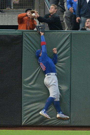 Chicago Cubs left fielder Jon Jay (30) can't bring back a Posey home run in the first inning as the Chicago Cubs face the San Francisco Giants at AT&T Park in San Francisco, Calif., on Tuesday, August 8, 2017.