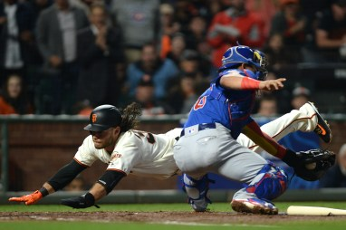 San Francisco Giants shortstop Brandon Crawford (35) scores in the fourth inning in front on the tag by Chicago Cubs catcher Willson Contreras (40) as the Chicago Cubs face the San Francisco Giants at AT&T Park in San Francisco, Calif., on Tuesday, August 8, 2017.
