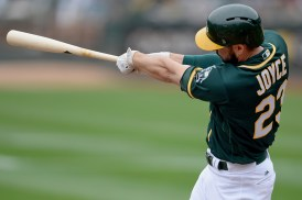 Oakland Athletics right fielder Matt Joyce (23) connects for a home run in the first inning as the Seattle Mariners face the Oakland Athletics at Oakland Coliseum in Oakland, Calif., on Wednesday, August 9, 2017.