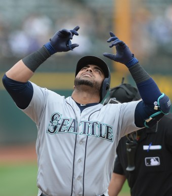 Seattle Mariners designated hitter Nelson Cruz (23) hits a home run in the third inning as the Seattle Mariners face the Oakland Athletics at Oakland Coliseum in Oakland, Calif., on Wednesday, August 9, 2017.