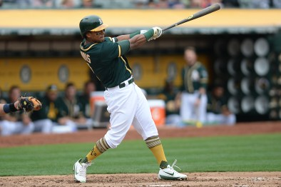 Oakland Athletics left fielder Khris Davis (2) connects for a home run in the third inning as the Seattle Mariners face the Oakland Athletics at Oakland Coliseum in Oakland, Calif., on Wednesday, August 9, 2017.