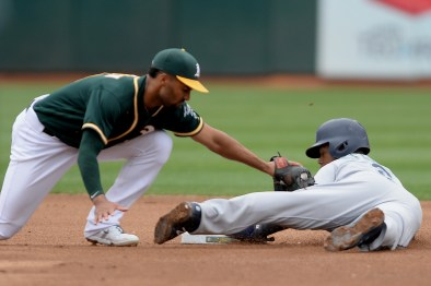 Seattle Mariners shortstop Jean Segura (2) steals second base in the fourth inning as the Seattle Mariners face the Oakland Athletics at Oakland Coliseum in Oakland, Calif., on Wednesday, August 9, 2017.