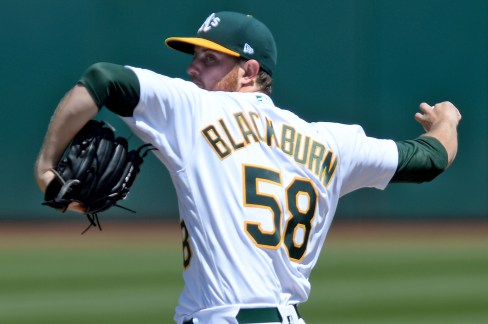 Oakland Athletics starting pitcher Paul Blackburn (58) throws a pitch in the first inning as the Kansas City Royals face the Oakland Athletics at Oakland Coliseum in Oakland, Calif., on Wednesday, August 16, 2017.