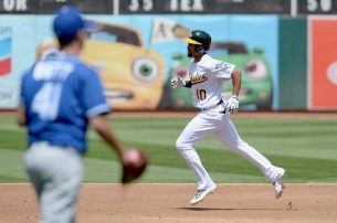 Oakland Athletics shortstop Marcus Semien (10) hits a home run in the third inning as the Kansas City Royals face the Oakland Athletics at Oakland Coliseum in Oakland, Calif., on Wednesday, August 16, 2017.