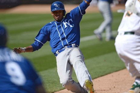 Kansas City Royals shortstop Alcides Escobar (2) scores in the ninth inning as the Kansas City Royals face the Oakland Athletics at Oakland Coliseum in Oakland, Calif., on Wednesday, August 16, 2017.