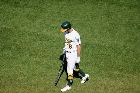 Oakland Athletics shortstop Chad Pinder (18) strikes out to end the game as the Kansas City Royals beat the Oakland Athletics 7-6 at Oakland Coliseum in Oakland, Calif., on Wednesday, August 16, 2017.