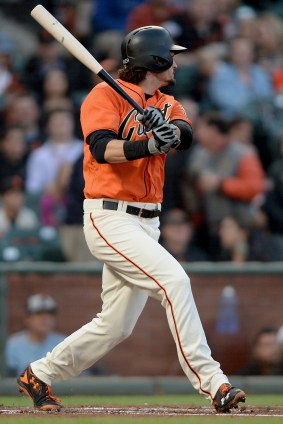San Francisco Giants left fielder Jarrett Parker (6) doubles in the first inning as the Philadelphia Phillies face the San Francisco Giants at AT&T Park in San Francisco, Calif., on Friday, August 18, 2017.