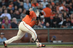 San Francisco Giants third baseman Pablo Sandoval (48) singles in the first inning as the Philadelphia Phillies face the San Francisco Giants at AT&T Park in San Francisco, Calif., on Friday, August 18, 2017.