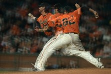 San Francisco Giants relief pitcher Cory Gearrin (62) throws a pitch in the seventh inning shown in a multiple exposure image as the Philadelphia Phillies face the San Francisco Giants at AT&T Park in San Francisco, Calif., on Friday, August 18, 2017.