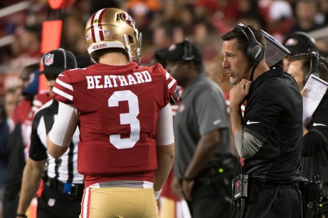 San Francisco 49ers quarterback C.J. Beathard (3) and Head Coach Kyle Shanahan talk on the sideline in the second quarter of the game against the Denver Broncos at Levi's Stadium in Santa Clara, Calif., on August 19, 2017.