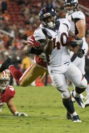 Denver Broncos running back Juwan Thompson (40) rushes for a 20-yard touchdown in the fourth quarter of the game against the San Francisco 49ers at Levi's Stadium in Santa Clara, Calif., on August 19, 2017.