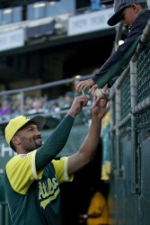 "Oakland Athletics shortstop Marcus ""Mahkus"" Semien (10) signs an autograph for a fan as the Texas Rangers face the Oakland Athletics at Oakland Coliseum in Oakland, Calif., on Friday, August 25, 2017."