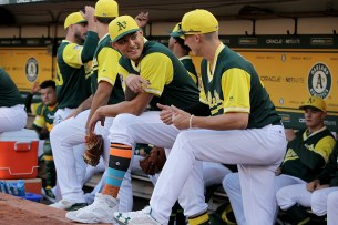 Oakland Athletics starting pitcher Sean Manaea (55) rocks colorful socks as the Texas Rangers face the Oakland Athletics at Oakland Coliseum in Oakland, Calif., on Friday, August 25, 2017.