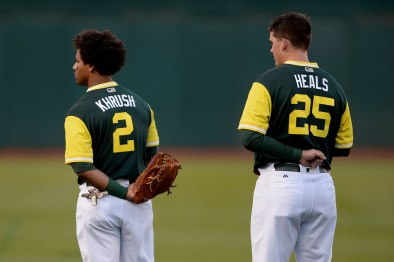"Oakland Athletics left fielder Khris ""Khrush"" Davis (2) and designated hitter Ryon ""Heals"" Healy (25) stand for the National Anthem as the Texas Rangers face the Oakland Athletics at Oakland Coliseum in Oakland, Calif., on Friday, August 25, 2017."
