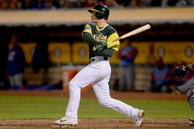 Oakland Athletics third baseman Matt Chapman (26) comes through with an RBI single in the seventh inning as the Texas Rangers face the Oakland Athletics at Oakland Coliseum in Oakland, Calif., on Friday, August 25, 2017. He was thrown out advancing to second base.