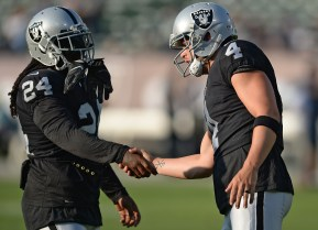 Oakland Raiders quarterback Derek Carr (4) and running back Marshawn Lynch (24) shake hands before the Seattle Seahawks face the Oakland Raiders at Oakland Coliseum in Oakland, Calif., on Thursday, August 31, 2017.